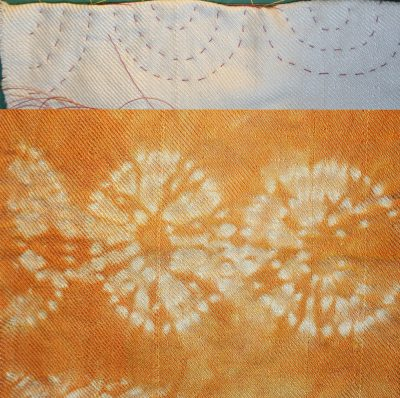 stitched shibori, orange circles, stitched on fold