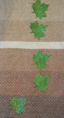devore, various values of brown weft against a cross-dyed green background