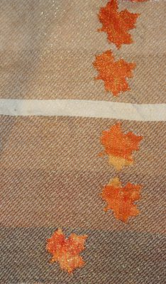 devore - various values of brown weft against an orange scrunch-dyed background