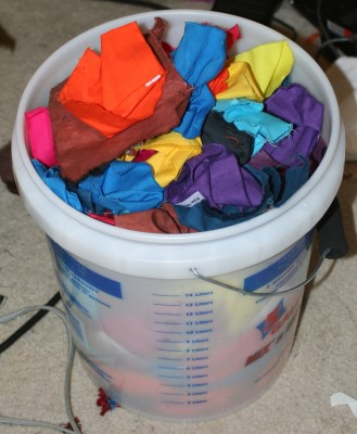 a five gallon bucket filled with dyed swatches!