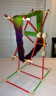 assembled Tinkertoy swift with a skein of yarn