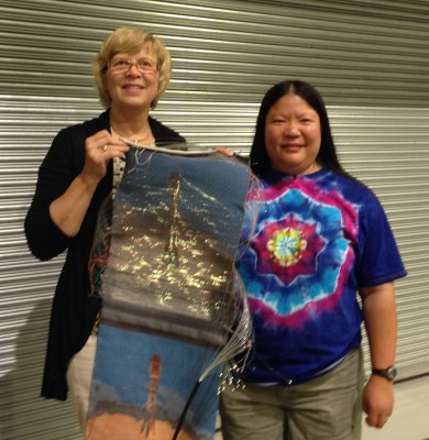 Tien and Laurie with fiber optic weaving