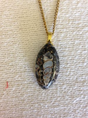 stone pendant, carved by Mom
