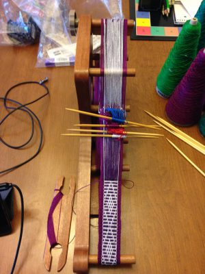 inkle loom with four heddle sticks