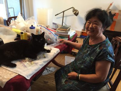 Fritz helping my mom with her beading