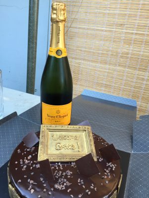 Welcoming Grace with cake and champagne!