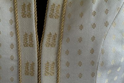 close-up of Tien's handwoven wedding coat