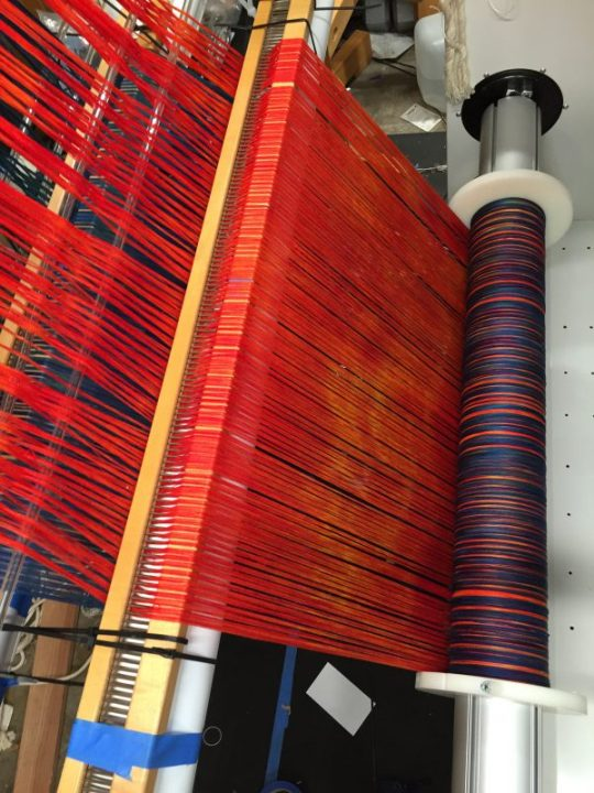 2nd red warp going onto the loom