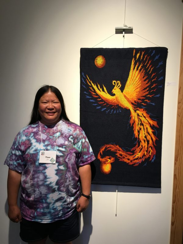 "Tien with phoenix piece ""Goodbye, Ma!"" at The Fine Line Creative Arts Center"