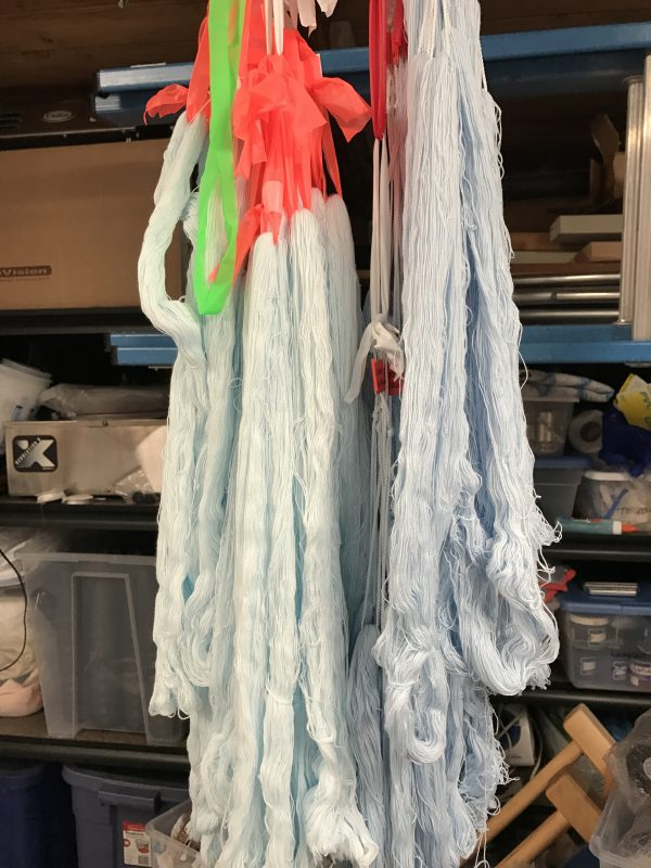 two sets of dyed skeins