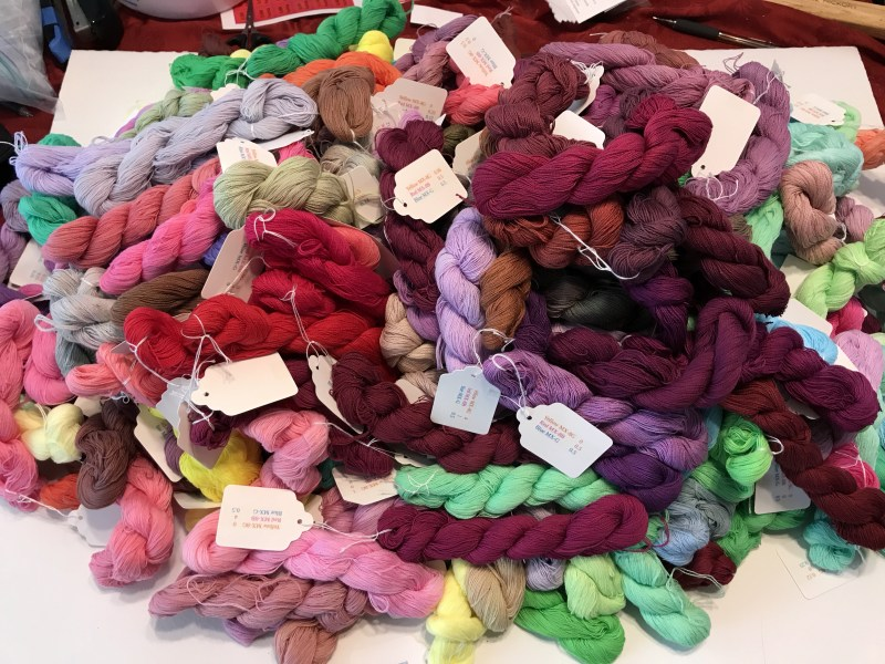"250 skeins, from the turquoise-fuchsia-sun yellow dye ""cube"""