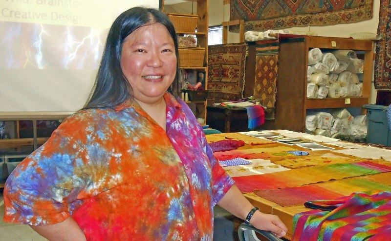 Tien talking at the San Diego Weavers Guild