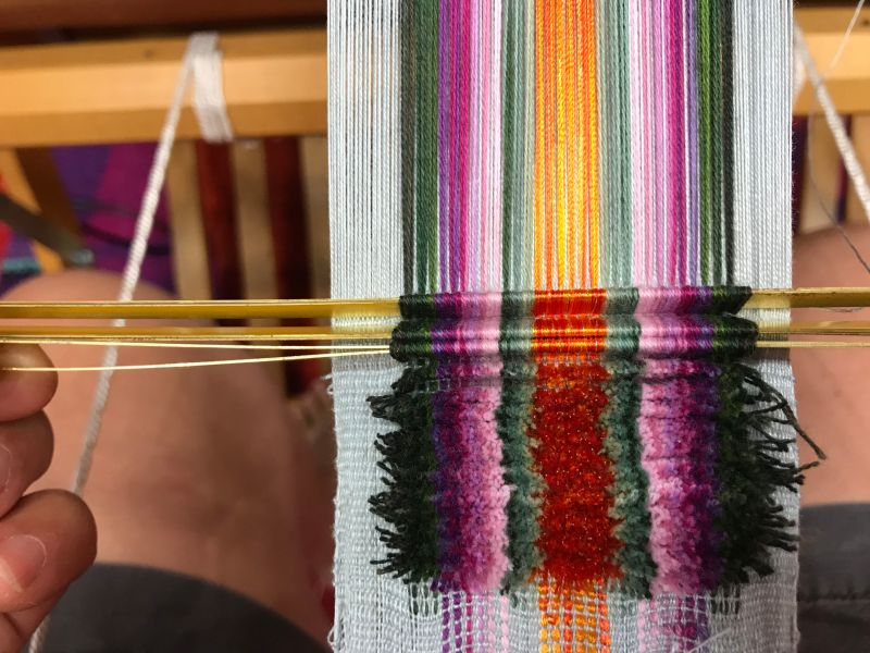 Velvet weaving showing rods