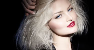 37824099 - platinum blond woman in black outfit.
