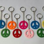 20 Llaveros Nenas/ Nenes Símbolo Paz ( 3