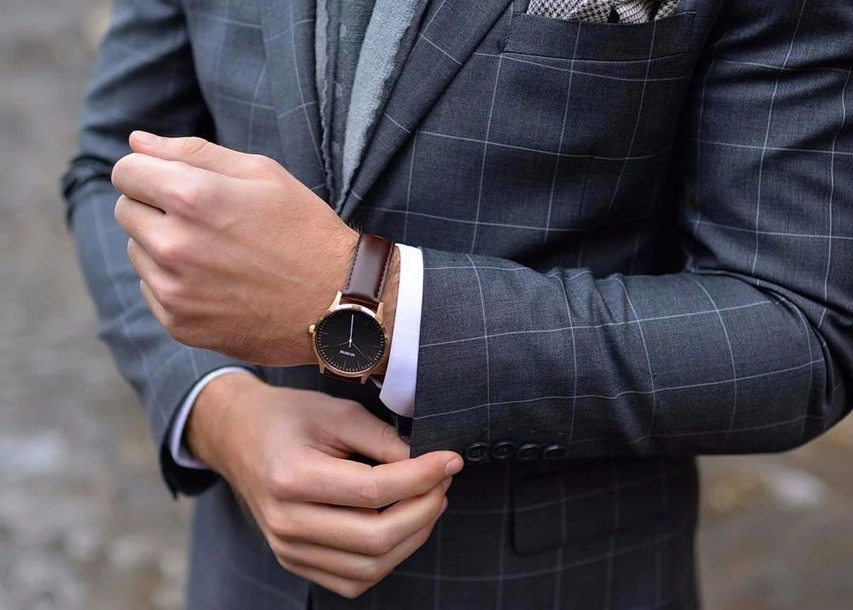 Man wearing a watch with a suit