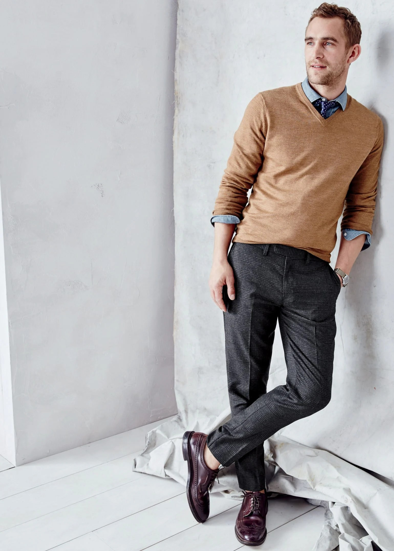 Man wearing a brown J. Crew v-neck sweater