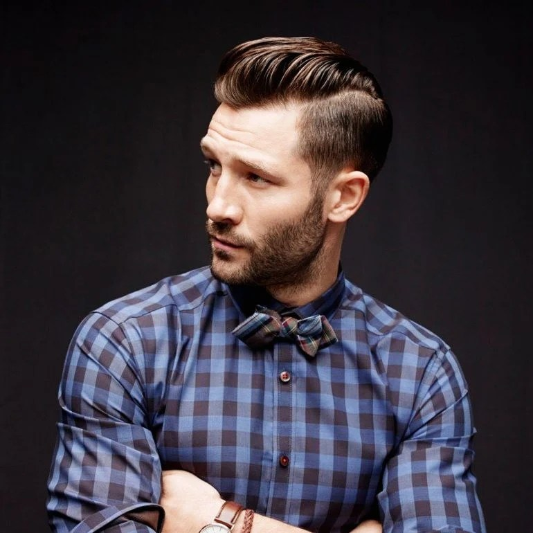 bearded man with checkered shirt and bow tie