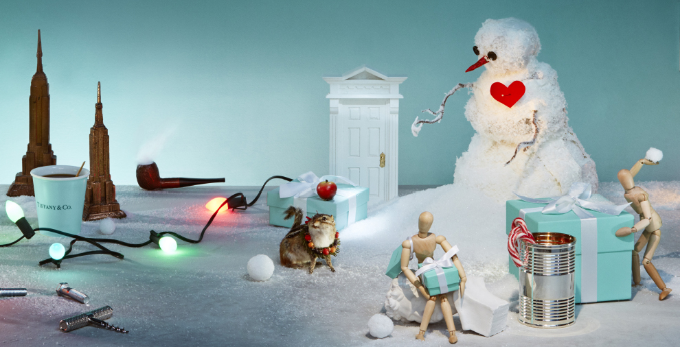 A scene of a fake snowman, model and fake cat surrounded by Tiffany & Co boxes
