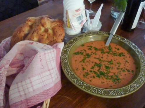 Large bowl of Gazpacho soup with pasrsley scattered on top