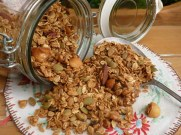 Jar tipped on side with granola cereal spilling out