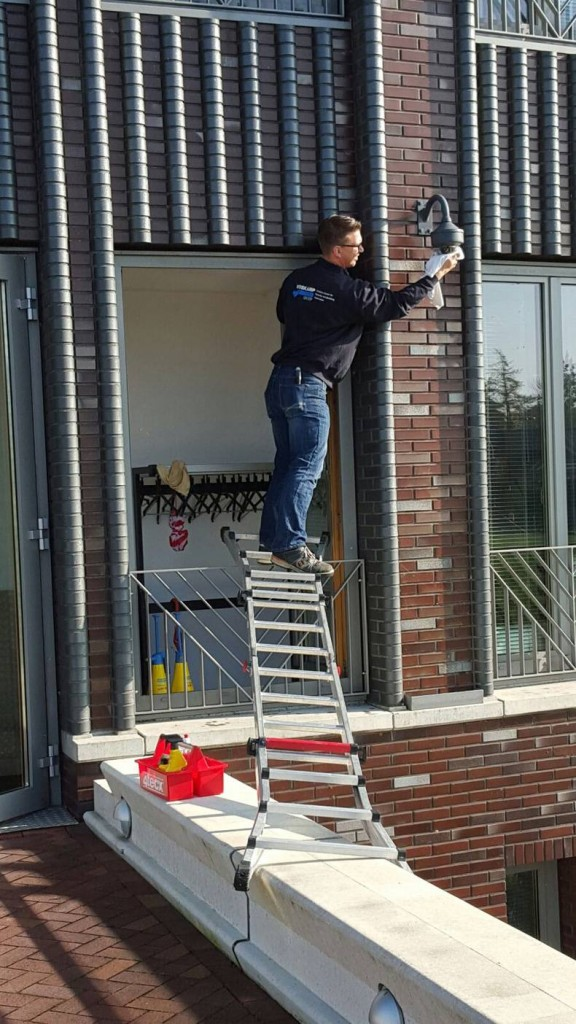 Using a ladder to change a bulb 576x1024 Using a ladder to change a bulb