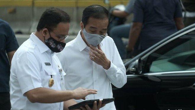 Ajak Warga Saling Dukung Lawan Covid-19, Anies Singgung Beratnya Beban Jokowi