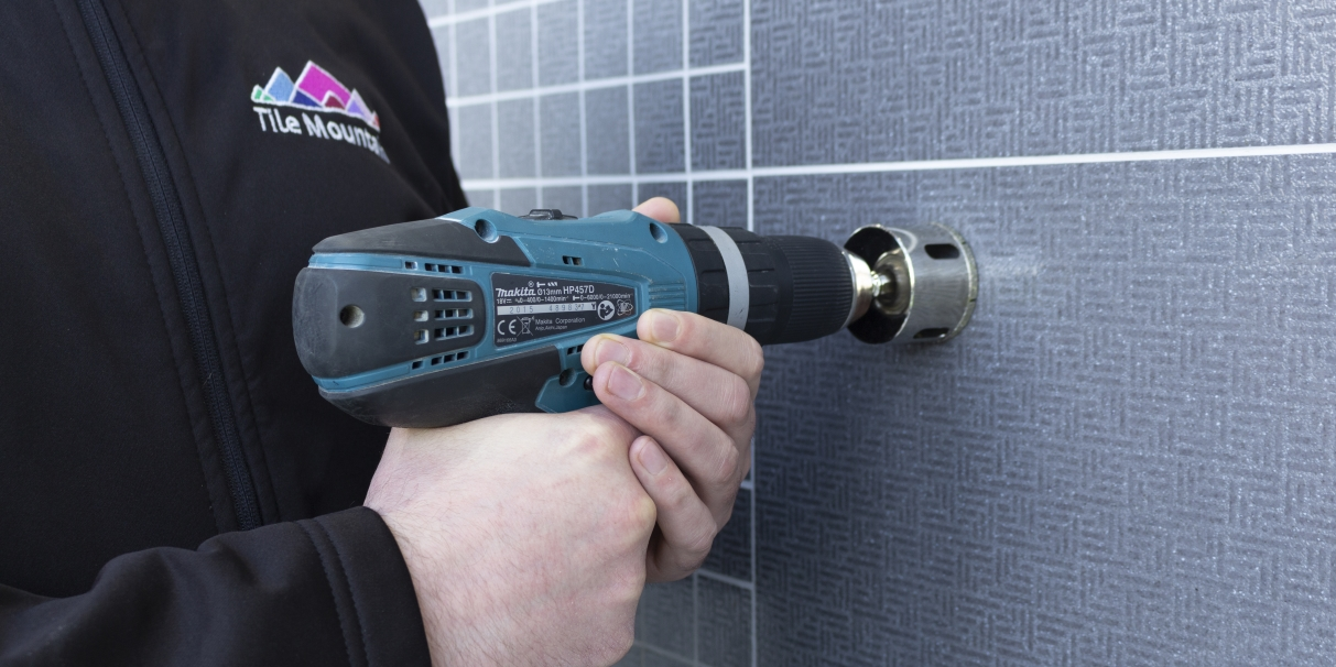 how to drill through tiles without