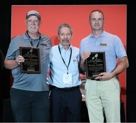 The first recipients of CTEF's Dan Hecox Service Award. Here, John Roberts (left) and Woody Sanders (right), are congratulated by Scott Carothers, CTEF director of certification and training.