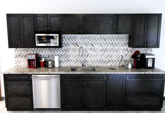 Edmonton Showroom Kitchenette with a stunning stone backsplash