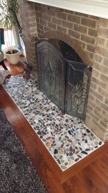 Beach Flat Pebbles installed on a fireplace