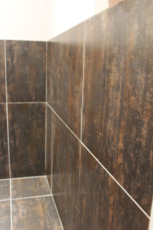 Metallic Copper Porcelain installed in a bathroom in a chiropractic office