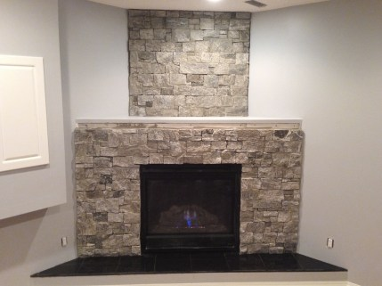 Mason Yosemite Ledgestone installed on a basement fireplace