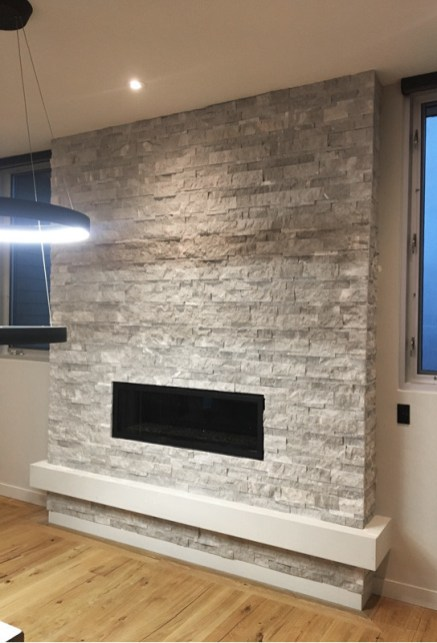 Ritz Gray Marble Splitface installed on a fireplace