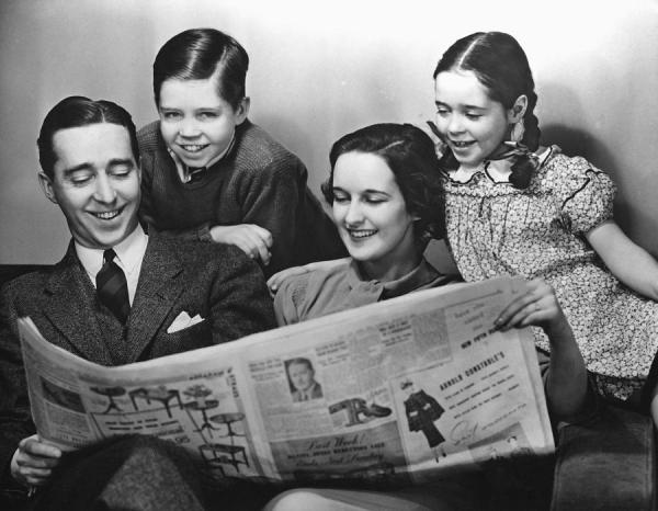 family-reading-newspaper-george-marks