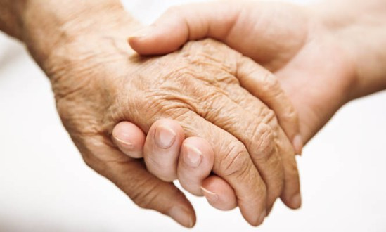 A_young_hand_holding_an_elderly_hand_665_x_400