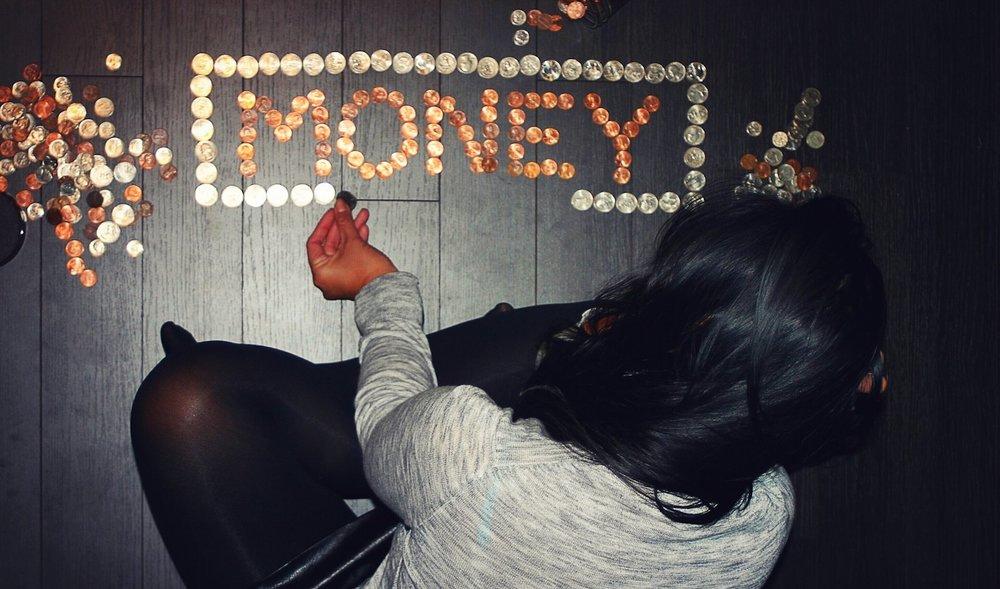woman arranging coins