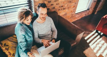 mother son reviewing finances and debt