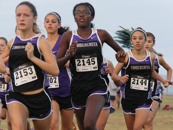 Timber Creek Cross Country runners participate in a 2014 meet. (Photo by Yearbook photographer Kaitlyn Cass.)