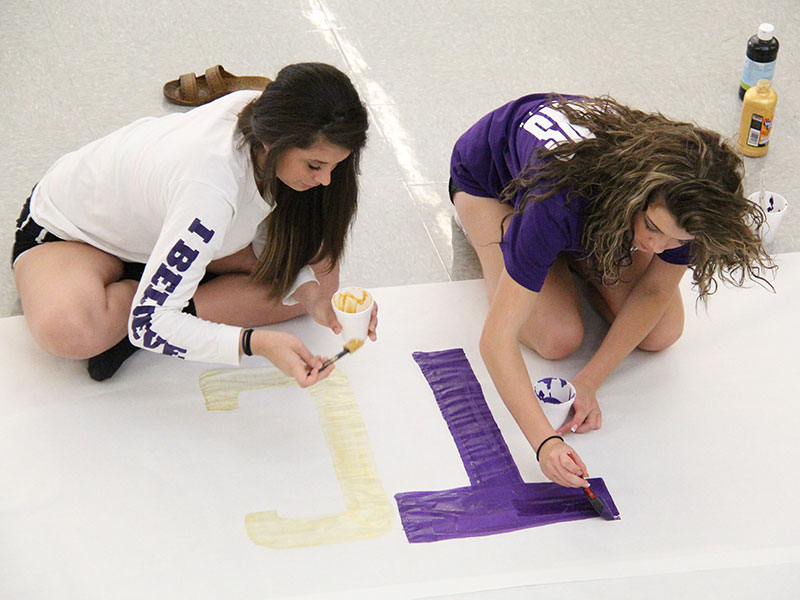 Student council members paint a spirit banner on Sept. 21, 2014.