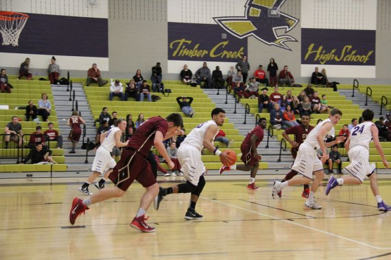 Timber Creek takes control of the ball during a Jan. 16, 2015 game against Central High School. (Photo by The Creek Yearbook photographer Robert Samudio)