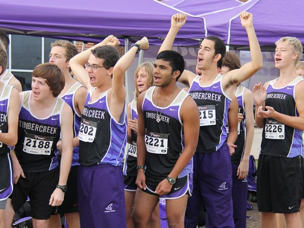Timber Creek boys cross country team cheers on their team during a Sept. 20, 2014 meet. (Photo by The Creek Yearbook photographer Kaitlyn Cass)