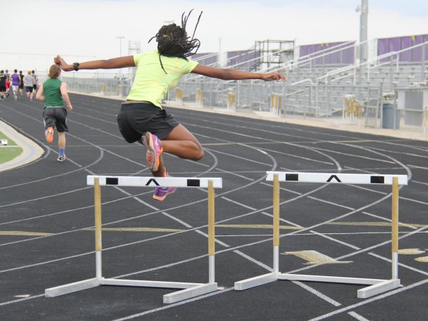 A Timber Creek track member jumps over a hurdle during a March 14, 2015 practice. (Photo by The Creek yearbook photographer Kelsey Crawford.)