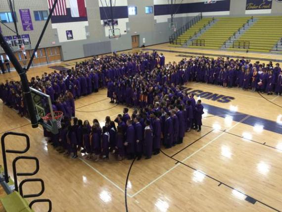 The Timber Creek Class of 2015 gathers into the shape of a 15 for a Senior picture.