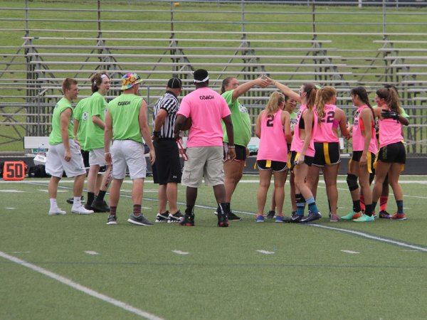 Seniors and juniors shake hands before the start of the 2015 Powder Puff game. (Photo by Talon photographer Hannah Dykes.)