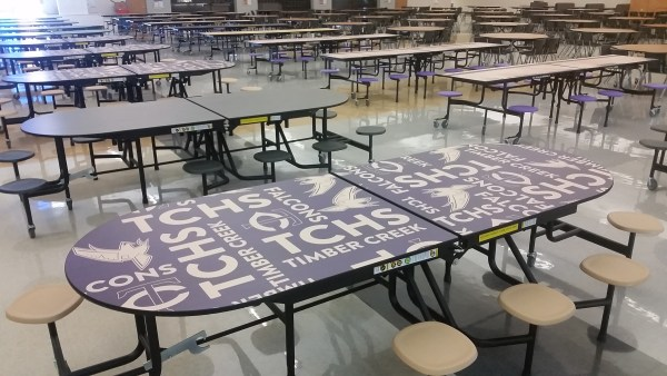 New colorful lunch tables show Timber Creek graphics and branding.