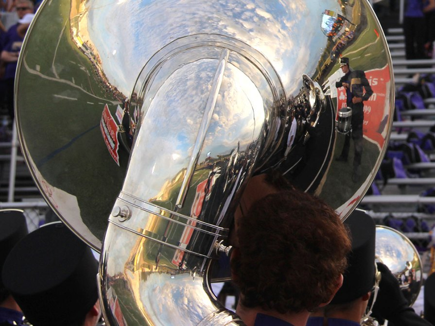 A view from behind a sousaphone player in shows a reflection of the Timber Creek High School Band. (Photo by The Creek Yearbook photographer J Haynes)