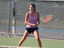 Tennis player Stephanie Wan practices on the Timber Creek court. (Photo by The Creek Yearbook photographer Tavin Stewart.)