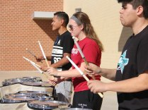 TCHS Drumline members practice outside on Feb. 11, 2016. (Photo by Grace Nakajima.)