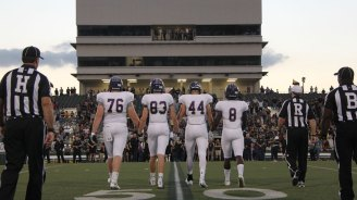 TCHS football players enter the field during the Sept. 23, 2016 game. (Photo by The Creek Yearbook photographer Josh Haynes.)